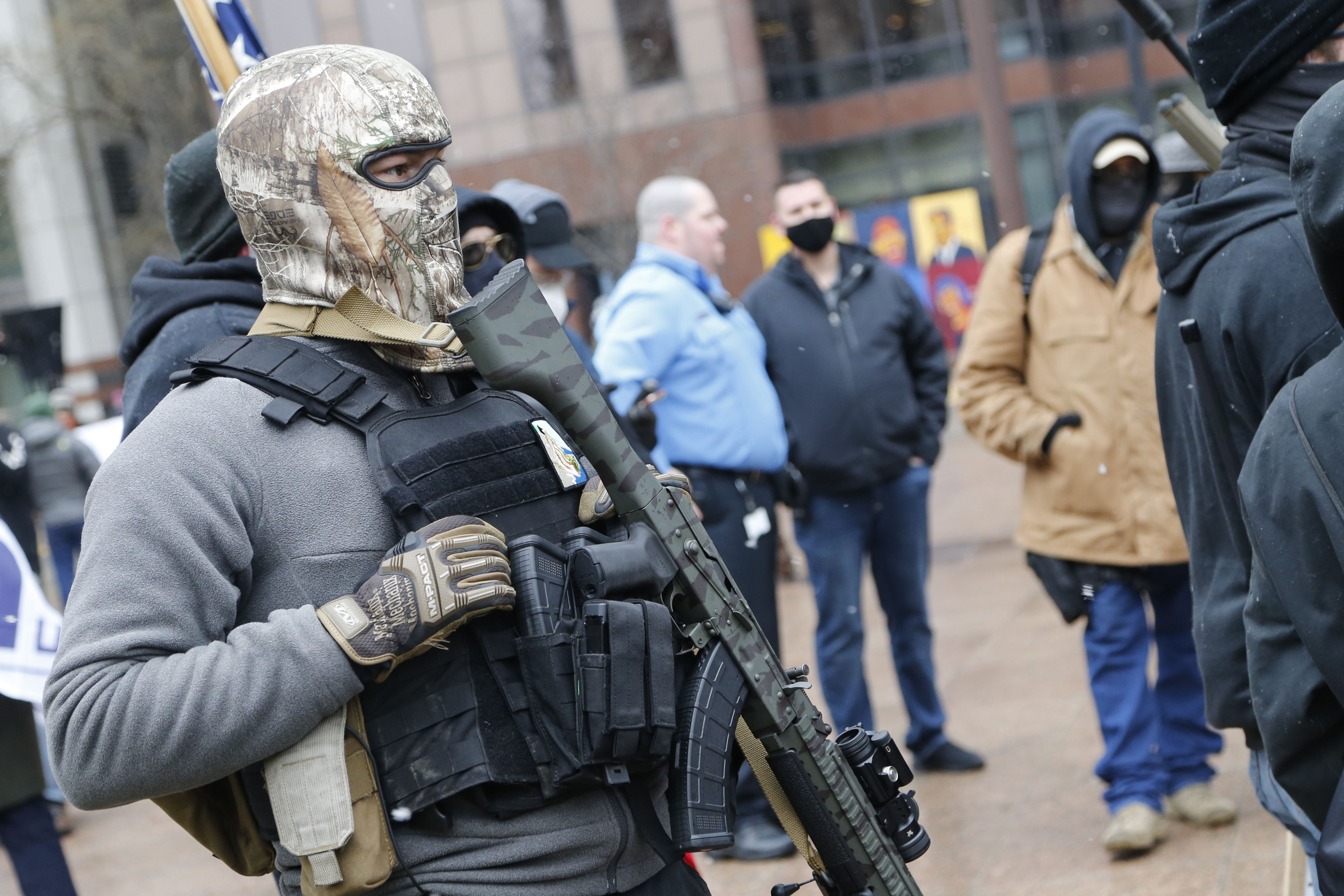 Armed protesters start to arrive at newly fortified US statehouses ahead of Biden's inauguration